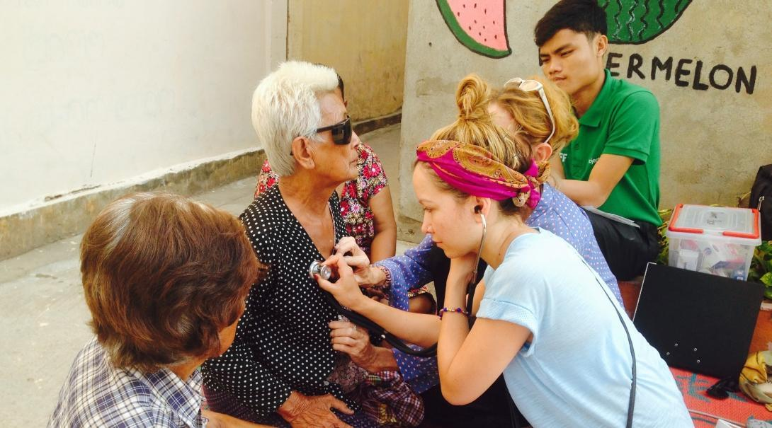 An intern is pictured conducting health screening as part of her public health internship in Cambodia.